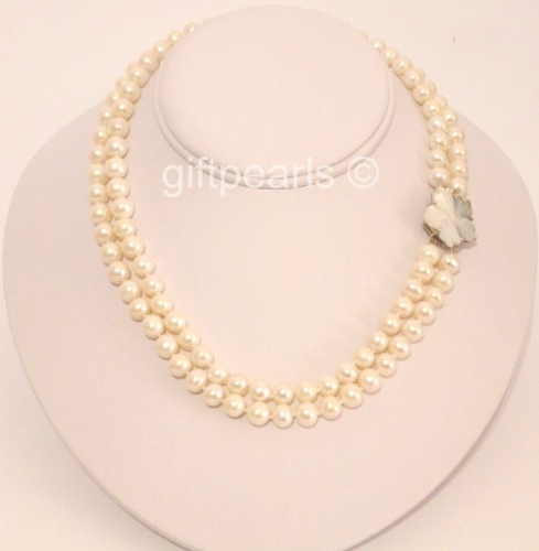 Classic White Double-Strand 7.5 - 8mm pearl necklace with mother-of-pearl clasp.